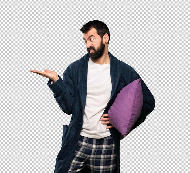 Man with beard in pajamas holding copyspace with doubts