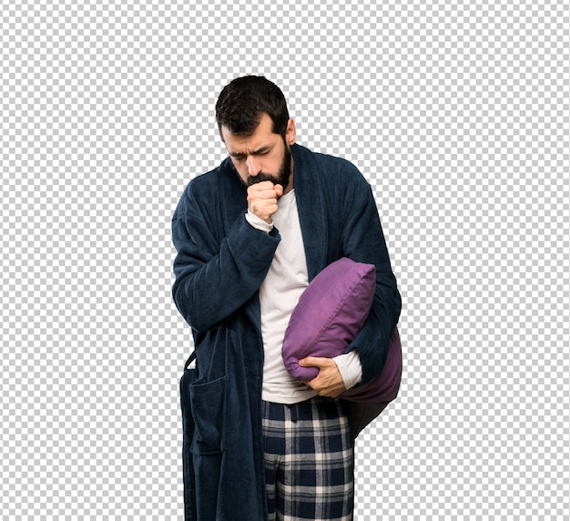 Man with beard in pajamas is suffering with cough and feeling bad