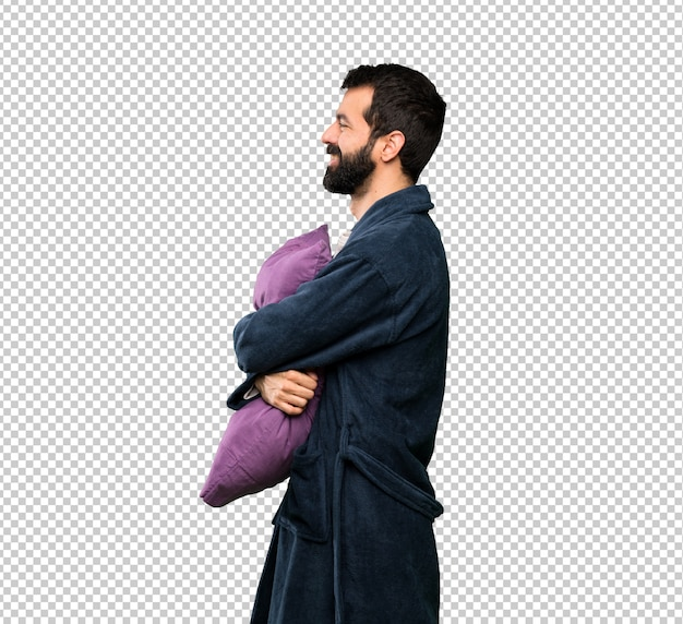 Man with beard in pajamas in lateral position