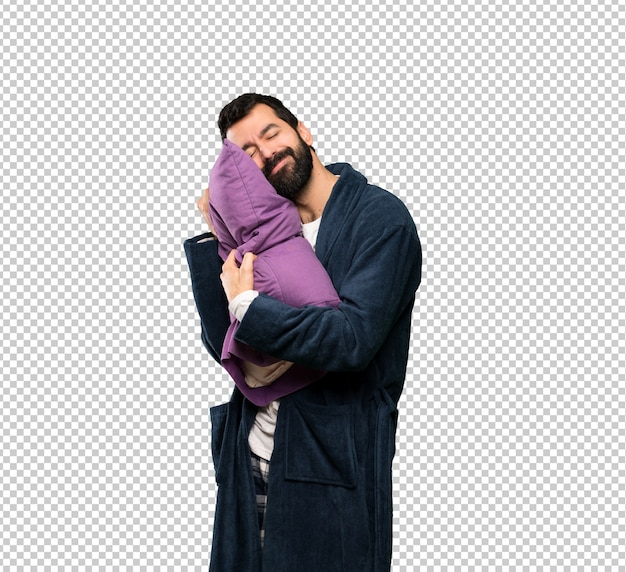 Man with beard in pajamas making sleep gesture in dorable expression