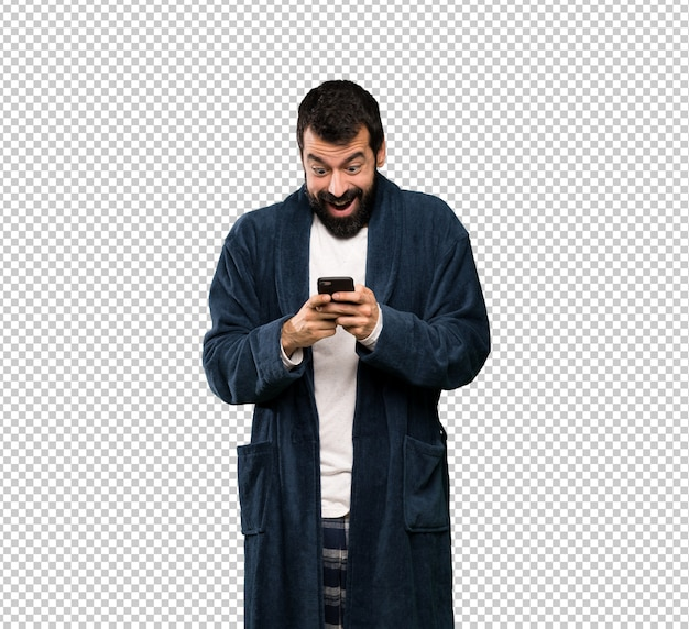 Man with beard in pajamas surprised and sending a message