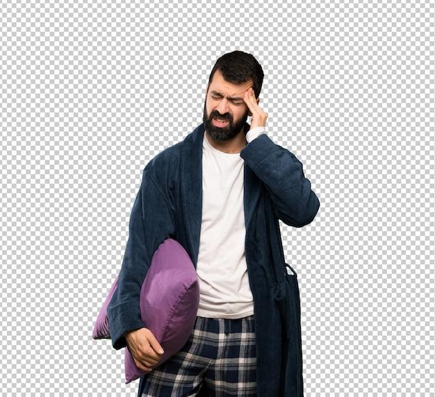 Man with beard in pajamas with headache