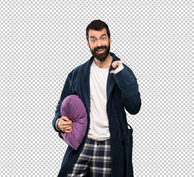Man with beard in pajamas with surprise facial expression