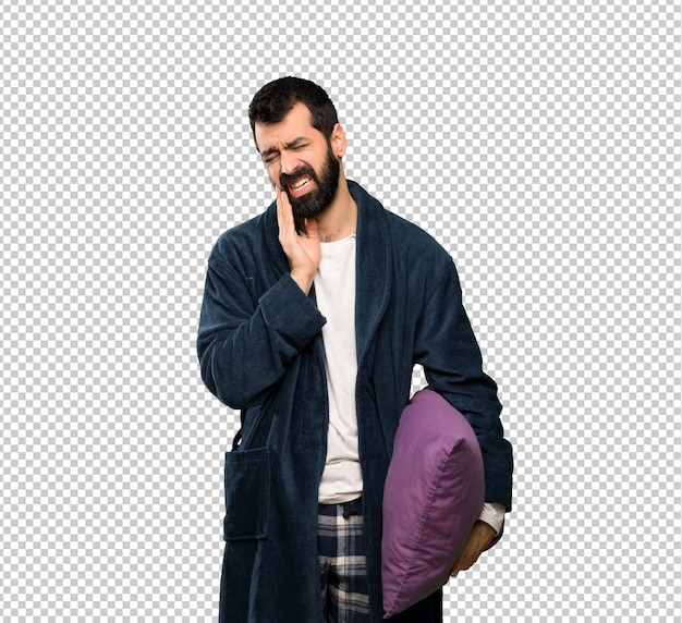 Man with beard in pajamas with toothache