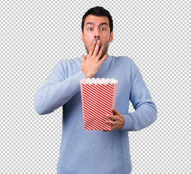 Man with blue sweater eating popcorns