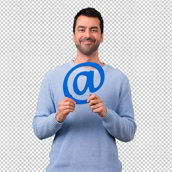 Man with blue sweater holding icon of at dot com