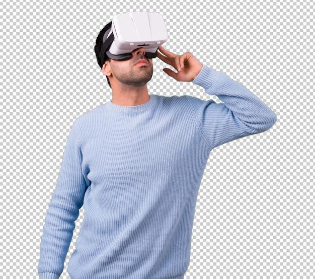 Человек с синим свитером с использованием очков vr. опыт виртуальной реальности