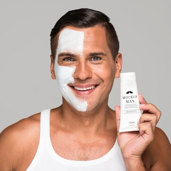 Man with cream of half his face