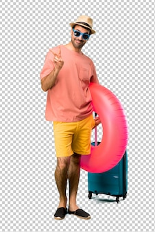 Man with hat and sunglasses on his summer vacation happy and counting two with fingers