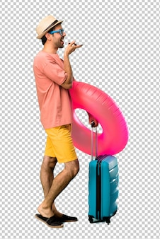 Man with hat and sunglasses on his summer vacation talking to mobile