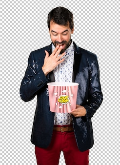 Man with jacket eating popcorns