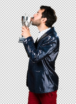 Man with jacket holding a trophy
