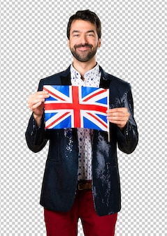 Man with jacket holding an uk flag