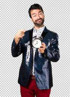 Man with jacket holding vintage clock