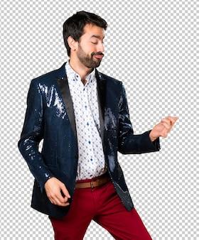 Man with jacket making guitar gesture
