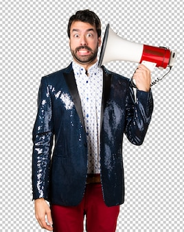 Man with jacket shouting by megaphone