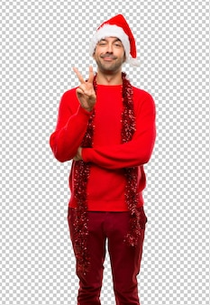 Man with red clothes celebrating the christmas holidays happy and counting two with fingers