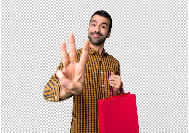 Man with shopping bags happy and counting three with fingers