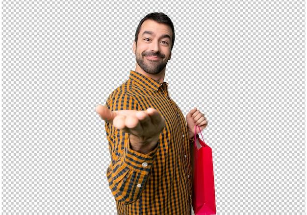손바닥에 copyspace 가상 들고 쇼핑 가방을 가진 남자 광고를 삽입