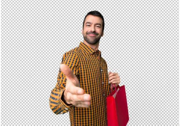 Man with shopping bags shaking hands for closing a good deal