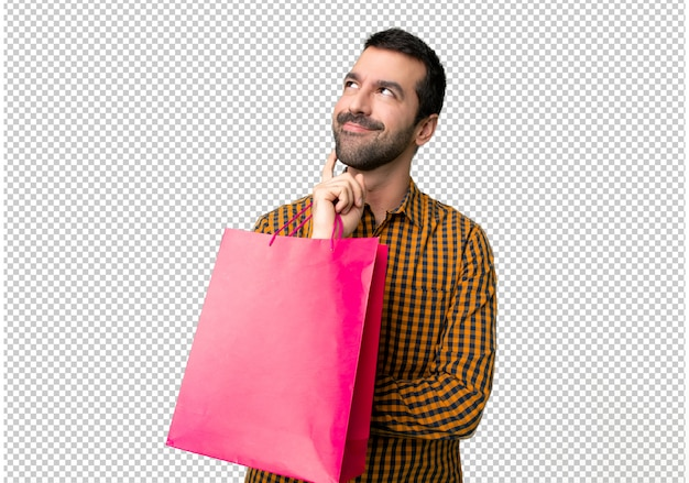 Man with shopping bags thinking an idea while looking up