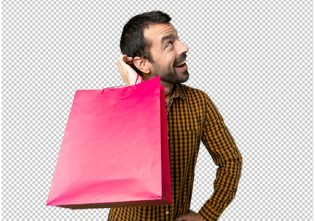Man with shopping bags thinking an idea while scratching head