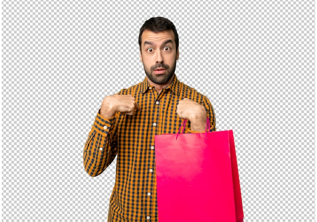 Man with shopping bags with surprise facial expression