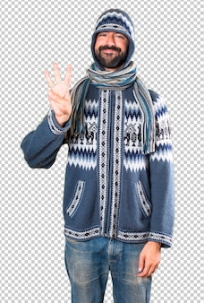Man with winter clothes counting three