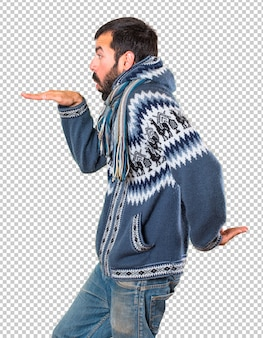 Man with winter clothes dancing