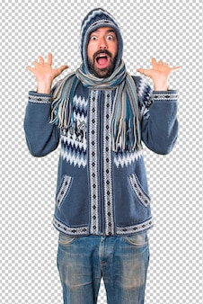 Man with winter clothes making surprise gesture