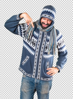 Man with winter clothes pointing down