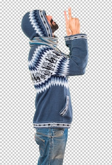 Man with winter clothes pointing up