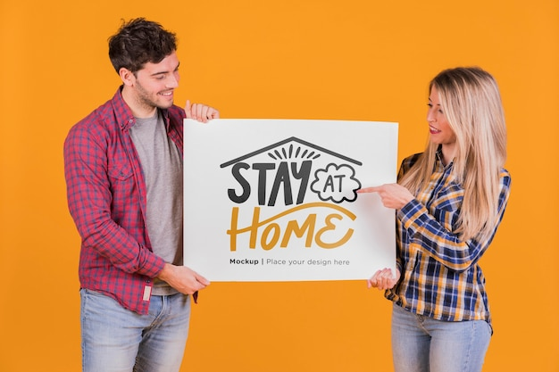 Man and woman holding a sign concept mock-up