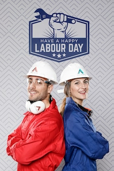 Man and woman with construction hat labour day