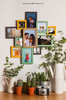 Many frames on wall with floral decoration