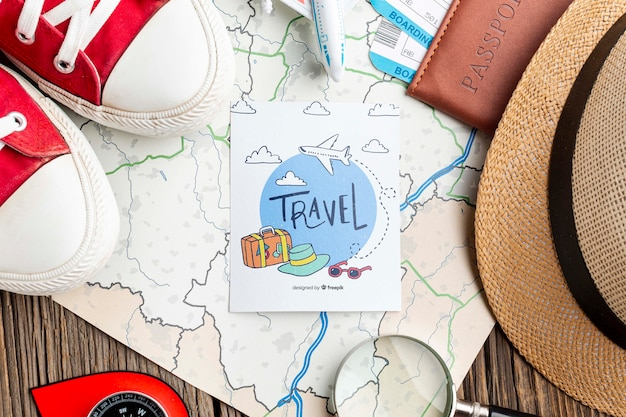 Map beside traveling tools mock-up
