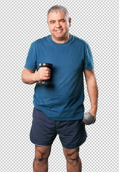 Mature man doing exercise with dumbbell