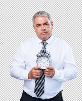 Mature man holding an alarm clock