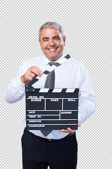Mature man holding a clapper