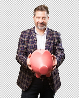 Mature man holding a piggy bank