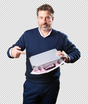 Mature man holding a suitcase