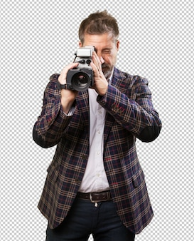 Mature man with a video camera