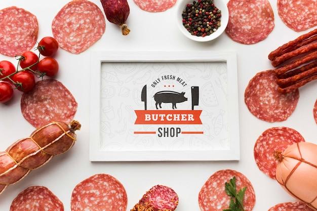 Мясные продукты с макетом в белой рамке