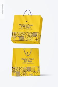 Средний бумажный подарочный пакет с макетом ручки из веревки, падающий