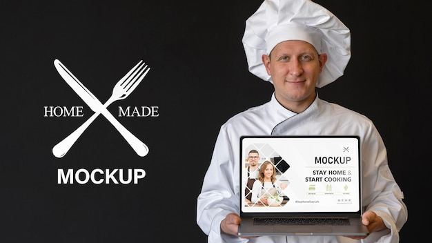 Medium shot chef holding laptop