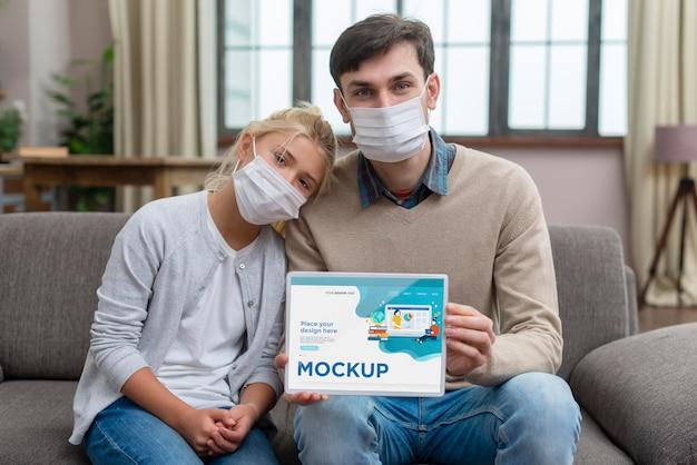 Medium shot girl and teacher wearing masks
