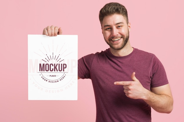 Medium shot of man holding a stationery mock-up card