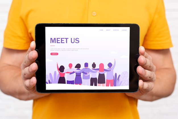 Meet us landing page on tablet held by man