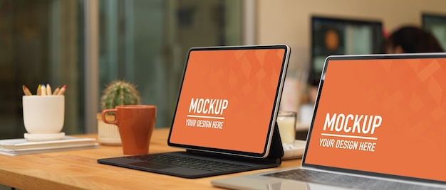 Meeting table with laptop tablet mockup and office supplies in office room