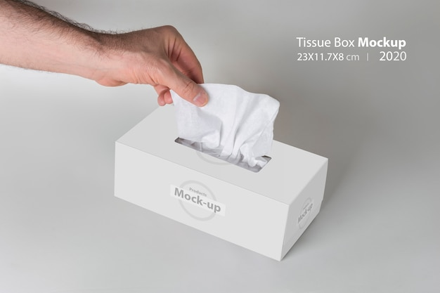 Men hand pulling a tissue from white tissue box on gray